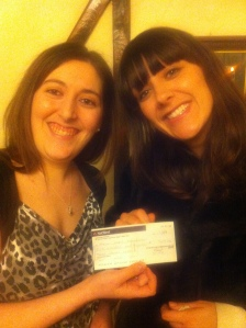 Gemma (l) presents the cheque to Charlotte Terry of Haven House (r)