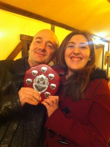 Joe Gurney (l) receives the Adrian Pembroke Memorial Shield from Gemma